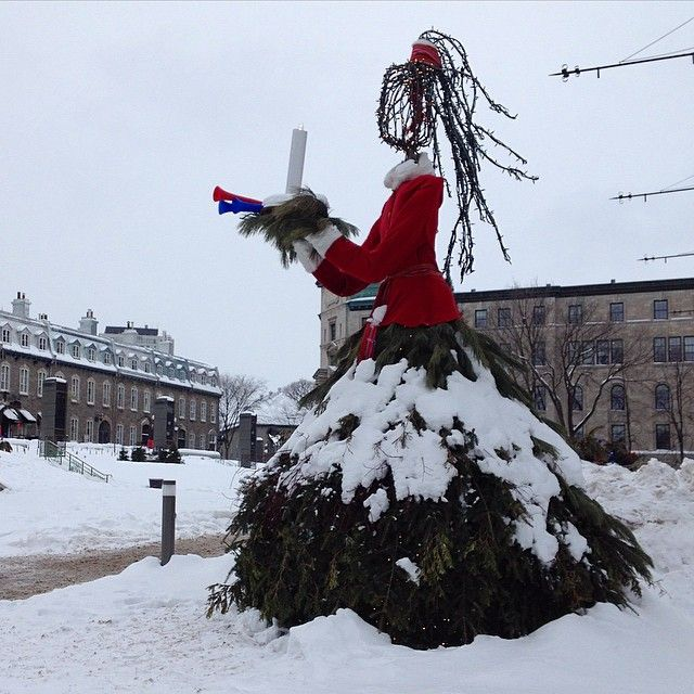 """""""Creative sculpture wearing an evergreen petticoat, flowing wooden hair tied back with the Quebec Carnival sash #quebeccity #quebeccarnival #evergreen…"""""""