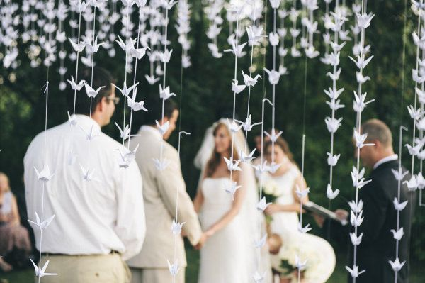 Paper crane backdrop for the backyard ceremony