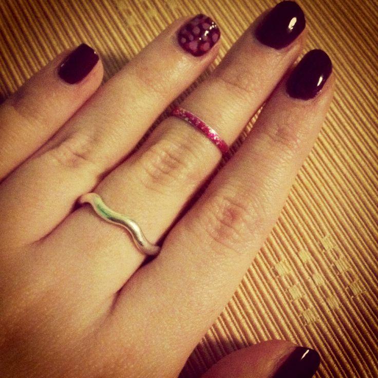 Purple nail polish with polka dots
