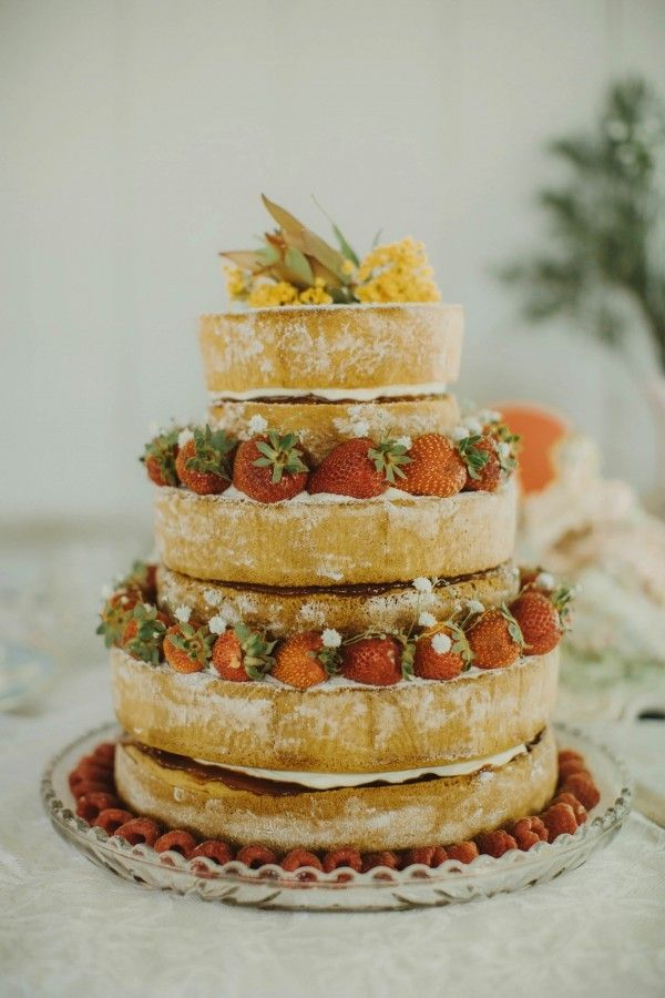A deconstructed naked cake is still the sweetest way to incorporate boho vibes into your dessert table | Image by I Got You Babe