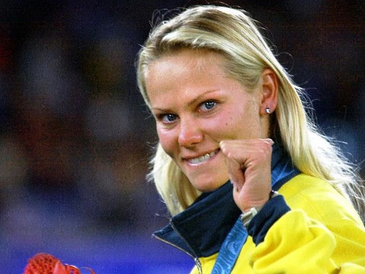 Tatiana Grigorieva of Australia clenches her fist in victory after taking silver in the women's Olympic pole vault competition at the Sydney Olympic Games.