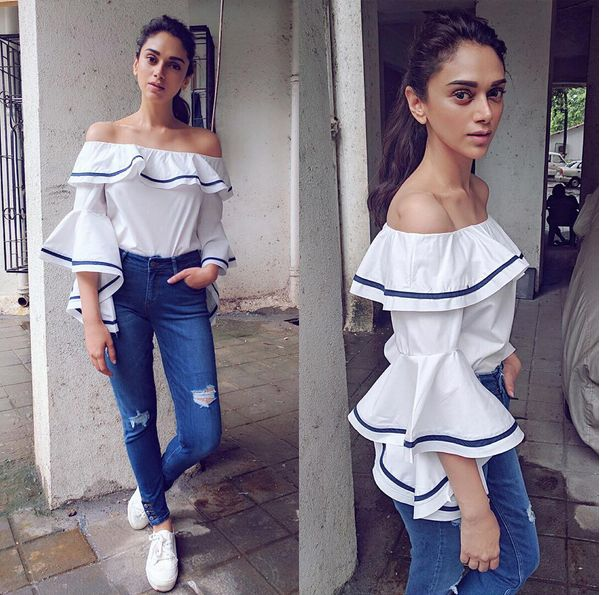 Glam Gal - Aditi Rao Hydari Glam Check - Celebrity stylish Sanam Ratansi gave Aditi a all time favorite casual white top and blue jean look, Understated Glamour comes alive in this picture!! The top by Madison OnPeddar has ruffled sleeves and neckline with blue lining steal the show in this look. The top with blue denim gets a glam makeover here.  The torn details on high waist blue denim by ZARA makes the look edgy. The white sneakers proves to be versatile yet again.