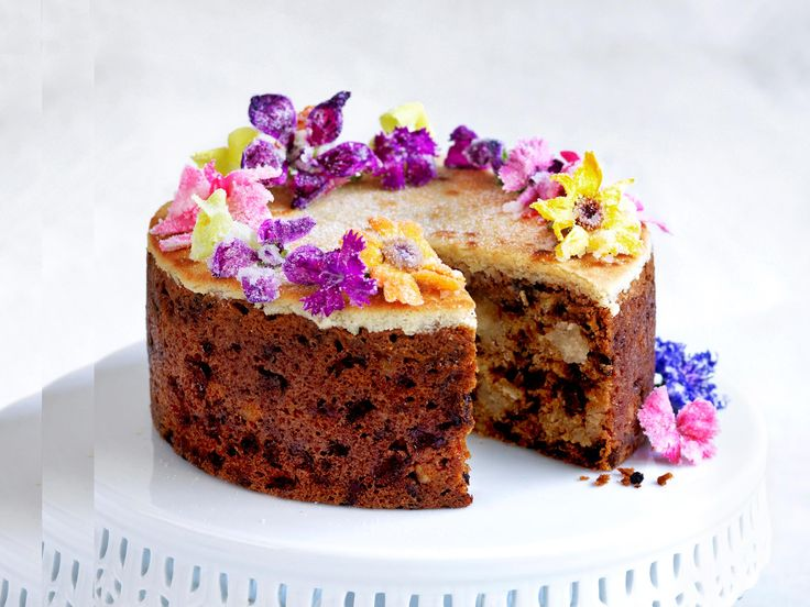 Packed with fruit, spices and marzipan, Simnel Cake is an Easter tradition. We've made ours with chunks of marzipan and decorated it with pretty flowers.