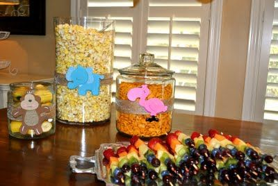 adorable rainbow fruit kabobs and animals that matched snacks for Noah's Ark party!
