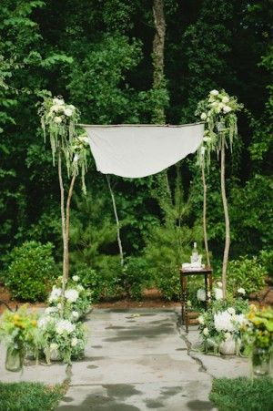 Chuppah With Branches and White and Green Flowers | photography by www.dixiepixelphoto.com/