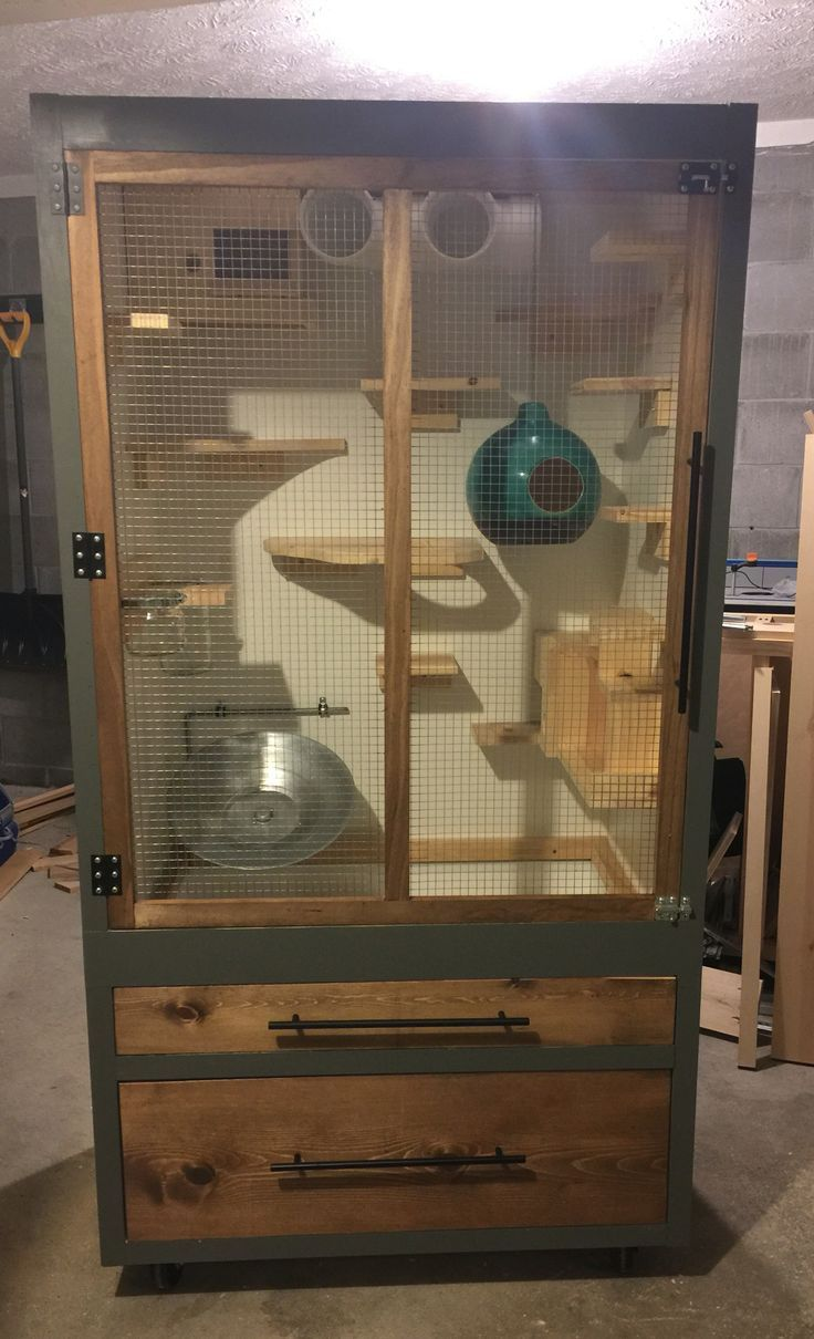 Homemade chinchilla cage converted from a wardrobe.