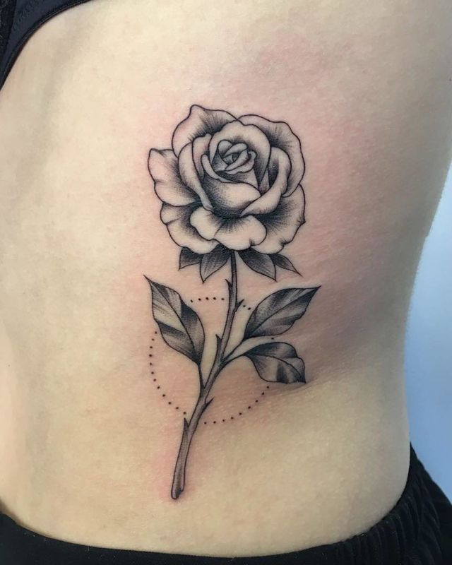 A Classic Black And Gray Stem Makes A Monochrome Impact Rose Drawing Tattoo Rose Tattoo Forearm Rose Tattoos