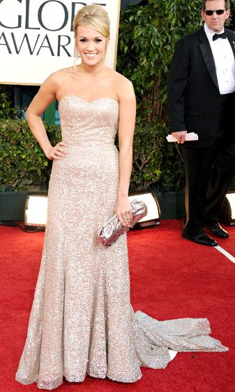Carrie Underwood in a strapless champagne-colored Badgley Mischka dress.