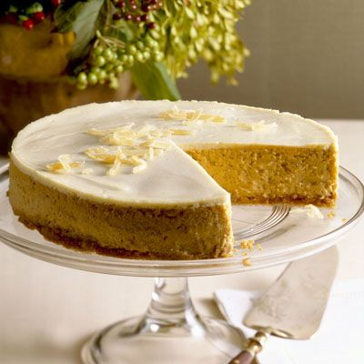 We kick up our Pumpkin Cheesecake with a small amount of bourbon — your guests won't be able to guess the secret ingredient! #pumpkinrecipes