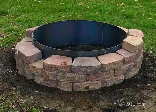 "Fire Pit Block Steel Liners Steel Fire Pit Ring Liners Higley Metals builds mild steel and ""no rust"" stainless steel fire pit liners for back yard firepits. We also fabricate custom fire pit screens and covers. http://www.HigleyFirePits.com or www.FirePitRing.com"