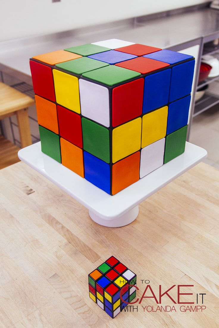 My Rubik's Cube Cake would make the perfect centerpiece for any 80s themed party! Layers of grid-patterned vanilla cake, chocolate ganache and fondant make the perfect puzzle. #Baking #Dessert