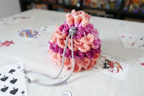 Hey, I found this really awesome Etsy listing at https://www.etsy.com/listing/583615062/dice-bag-crochet-dragon-scale-pink-and