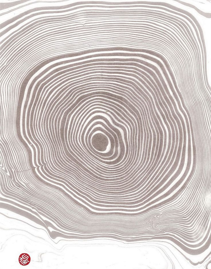 This is a Japanese print technique called Suminagashi Marbing... looks like tree rings, and could be a really cool brand tool.