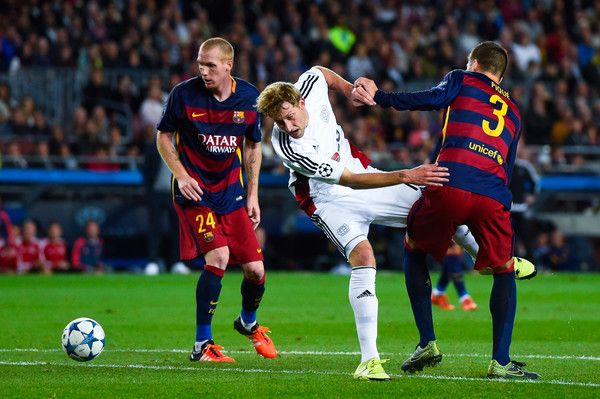 Stefan Kiessling of Bayer 04 Leverkusen competes for the ball with Jeremy Mathieu (L) and Gerard Pique of FC Barcelona during the UEFA Champions League Group E match between FC Barcelona and Bayer 04 Leverkusen on September 29, 2015 in Barcelona, Catalonia.