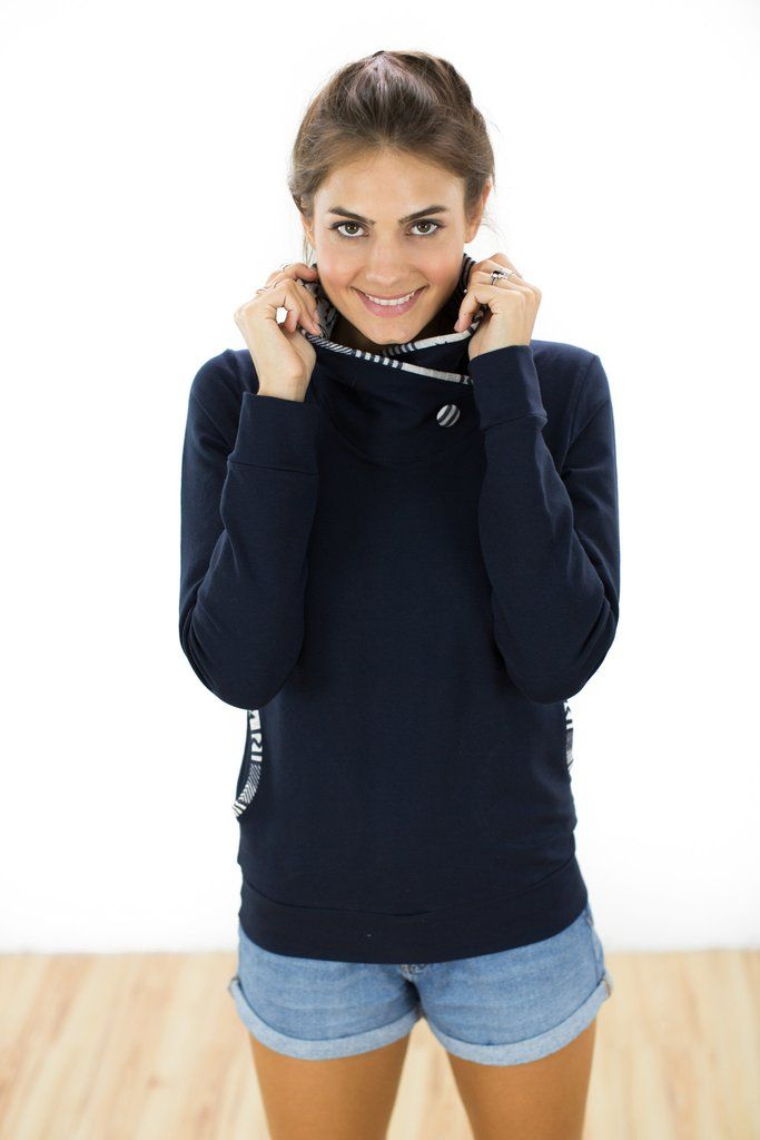 Sweatshirt Cherry Oh Navy Sweatshirt in navy. This ultra cosy sweatshirt will be the first thing you reach for when you're rushing out the door. The crossed turtleneck, with blue and cream aztec print lining will keep you nice and warm, while the side pockets, with the same aztec trim, give this sweatshirt a more casual touch. Plus, it requires little to no effort, simply pair it with skinny jeans and booties and you'll be out the door in no time! A large striped button decorates the…