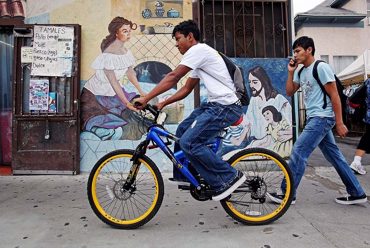 LOS ANGELES — LOS ANGELES, CA - JULY 27, 2010: Jarlin Leonel Hernandez, left, and Melvin Alexander Lopez make their way through Boyle Heights to Roosevelt Senior High School where they are taking an ESL summer school class. (Katie Falkenberg / For The Times)