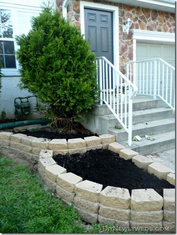 Landscaping for frontyard by stairs...lots of flowers!!  -diynewlyweds.com