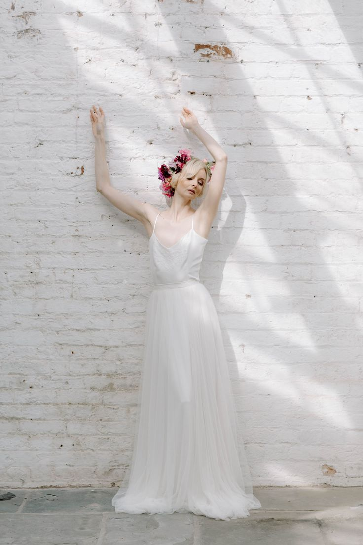 As the mornings are getting darker it's making me think about the beauty of light. I just love this photo of Vicky dancing in the light.⠀ ⠀ Vicky is wearing the Lily skirt and Jasmine top and a stunning flower crown of sweetpeas created by @pheasantbotanica.⠀  Styled by @For the Love of Weddings - Wedding Planning Styling & Design