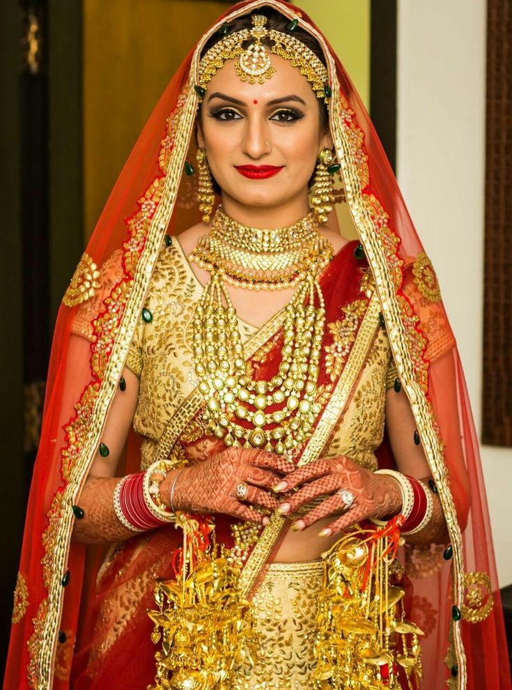 Bride - Portraits - Gold Lehenga with a Crimson Red Dupatta | WedMeGood | Gold Gota Patti Lehenga with Crimson Red Dupatta with a Gold Choker Set and Polki Necklace, Maatha Patti and Gold Kaleere  #wedmegood #bridal #gold #crimson