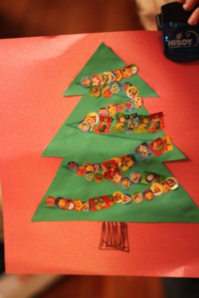 Sticker Christmas Tree Craft for Kids ~cut 2 Christmas trees out of green scrapbook paper & glue to a red piece of scrapbook paper. ~use a marker or paper to make a trunk ~Then decorated the trees, however they like! ~or draw lines for garland to give kids a little bit of a challenge.