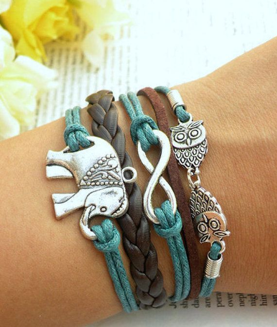 Fashion Bracelet with Elephant, Owls and Infinity Charms  A combination of Chocolate Brown Leather, Auburn Suede and Bondi Blue Rope What is