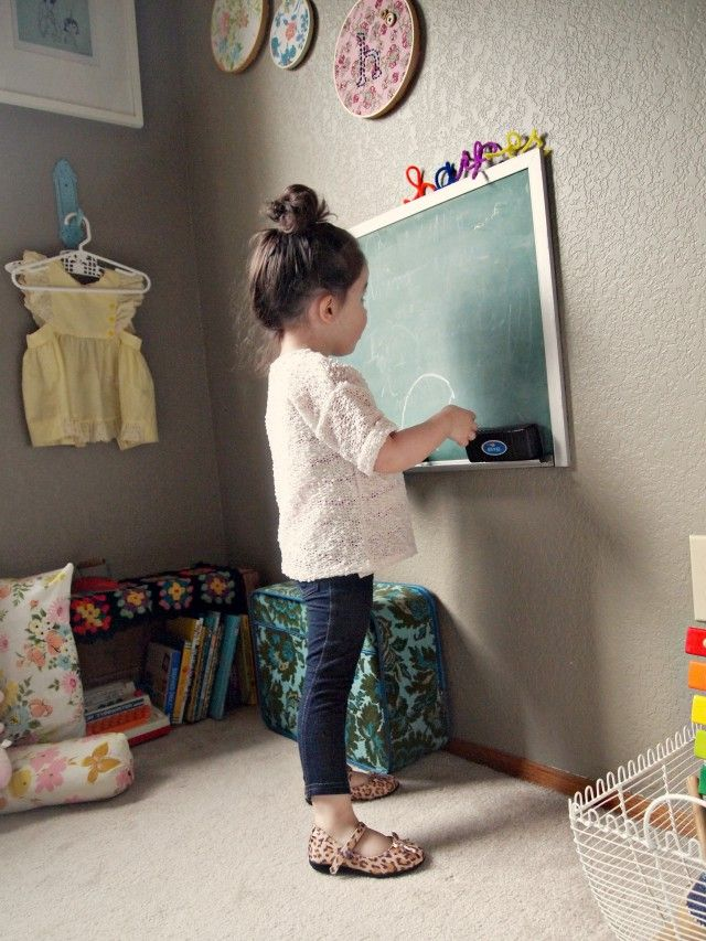 Mini-topknot for hair, I also love the outfit and blackboard.
