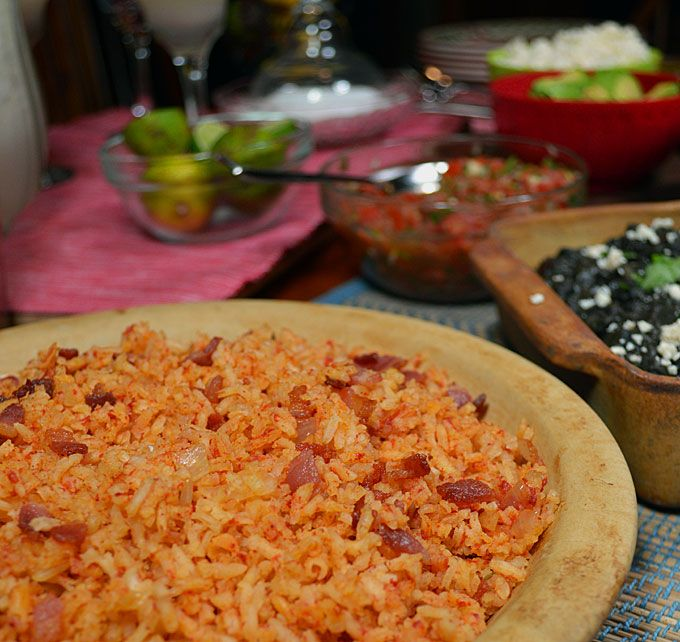 "Spicy Southwestern Rice is a perfect accompaniment for all your South of the Border meals. Serve it up with Carne Asada Street Tacos, Black Beans made with a little Negro Modelo,  and a blended Sweet and Sour Margarita for a complete meal that will have you singing ""Livin La Vida Loca"" in no time flat!"