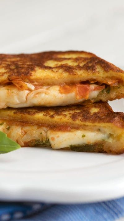 Think of this sandwich, stuffed with Mozzarella cheese, pesto and more, as French toast with some Italian flare.