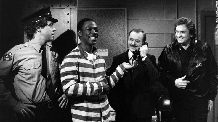 """Joe Piscopo, from left, Eddie Murphy, Brian Doyle-Murray, and Johnny Cash perform a """"Saturday Night Live"""" skit on April 17, 1982."""