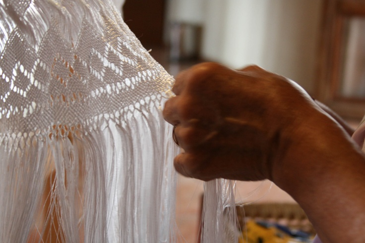 """The procedure to make a rebozo takes 30 to 60 days and has 15 steps, including reeling, yarn dyeing warp, the making of the fabric that is made in a loom, and the """"enpuntado"""", which is the delicate diamond-shaped weaving at each end, that part of the garment is called """"rapacejo"""". Once completed, it's ironing in a wooden press, which is the final phase of the elaboration of the rebozo of Santa Maria, which adorns Mexican women and that is the pride of Mexico and the state of San Luis Potosi."""