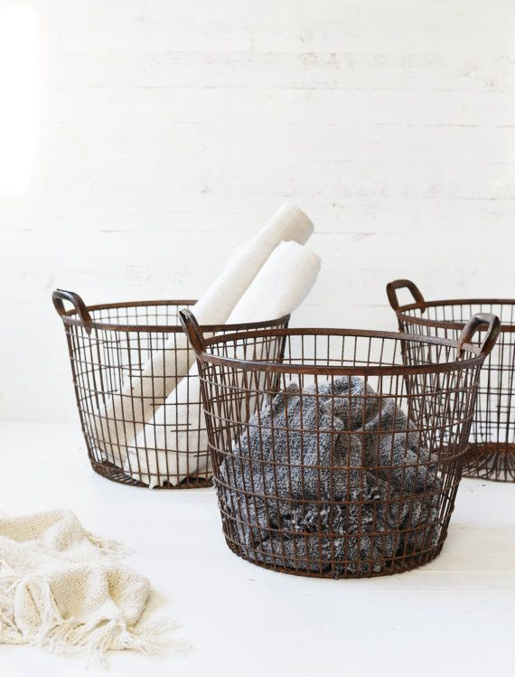 vintage French potato gathering wire basket  these wire baskets originate from France. they were used for gathering potatoes on the fields. now the wire baskets are a great addition to any modern rustic or country styled home. you can have them next to the fire place for storing wood or blankets and cushions.  color: some rust color, agreeable deep weathered brown  look and feel: sturdy, industrial, modern rustic look  condition: excellent vintage condition no lose wires or holes…