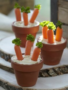 Kids will definitely eat there vegetables when they look as cute as this! Make flower pot hummus dip for your  party.