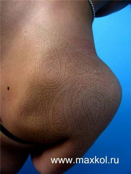 White ink paisley tattoo