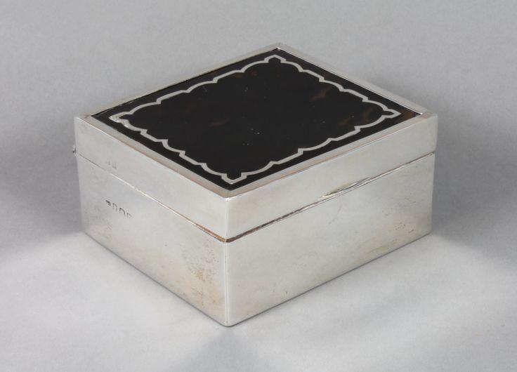 A tortoiseshell and silver cigarette/trinket box, est £100-150