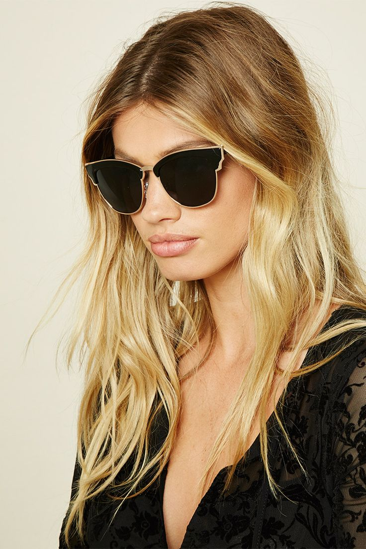 A pair of browline sunglasses featuring winged top bar and high-polish accents.
