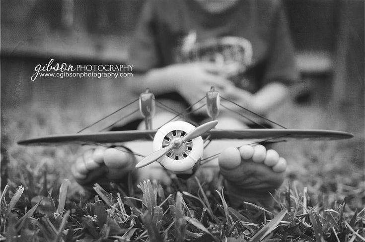 Cute little boy picture with an airplane.