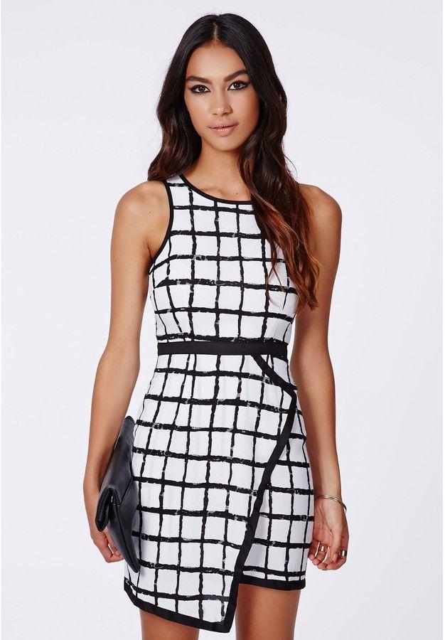 Blanka Asymmetric Hem Shift Dress Black Grid is on sale now for - 25 % !