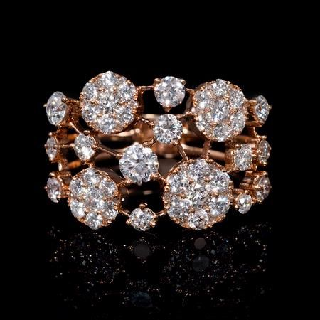 This stylish 18k rose gold ring, features 65 round brilliant cut white diamonds of F color, VS2 clarity, with excellent cut and brilliance, weighing 1.36 carats total.