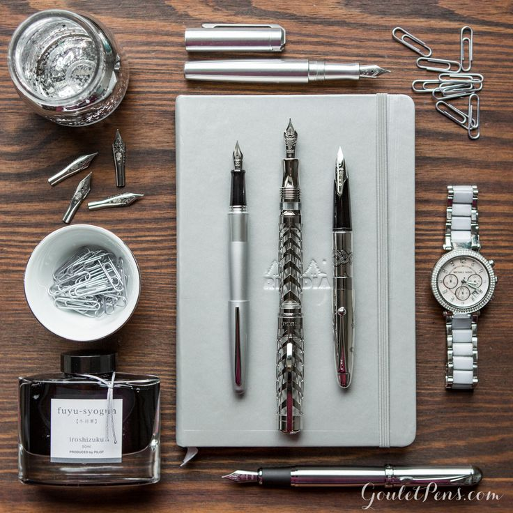 Silver fountain pens, notebooks, and ink make this arrangement the silver lining we've been looking for!
