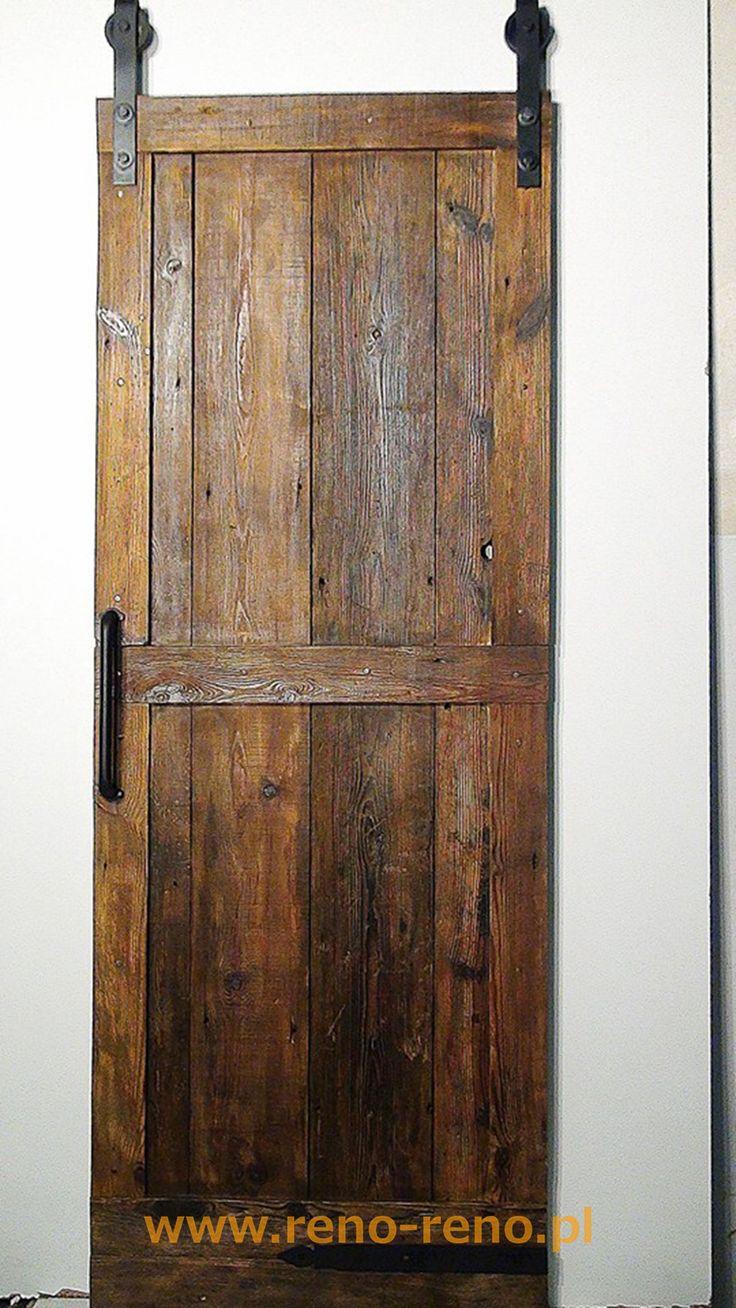 Drewniane drzwi przesuwne. Klasyczny, lekko rustykalny styl. Pracownia Reno.