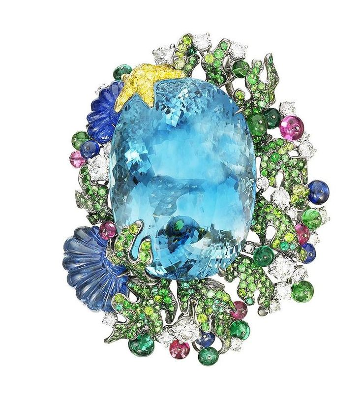 Anna Hu Siren's Aria brooch in white gold, set with a 103.72ct aquamarine, a carved blue sapphire shell, emerald, tsavorite and sapphire beads, diamonds, sapphires and Paraiba tourmalines.