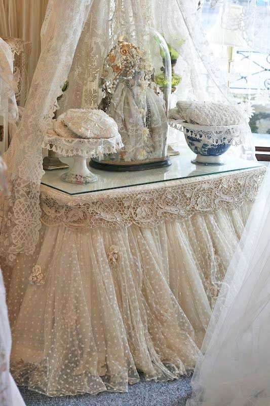 Drape a table/desk with beautiful lace and cover with a glass top.