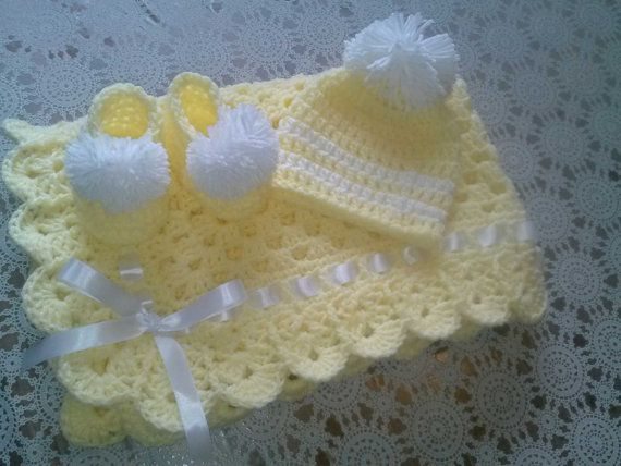 Very soft and cuddly yellow crochet granny square baby blanket gift set. Baby Blanket Set: Granny Square Baby Blanket, Beanie Hat and Booties    Baby blanket has white satin ribbon/bow - Beanie hat has a large white pom-pom   Made from one of the softest yarns on the market - Bernat Softee Baby Yarn    100% acrylic baby yarn for easy machine wash and dry. Perfect for newborn baby girl or boy. Ideal for baby shower gift. Blanket measures 33 inches x 33 inches Newborn Beanie Hat: 12-13 dia…