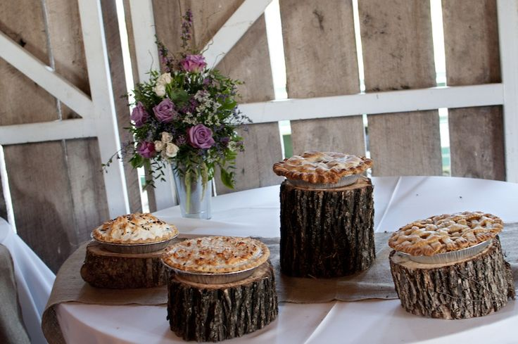 small logs of different sizes make creative cake stands - thereddirtbride.com - see more of this wedding here