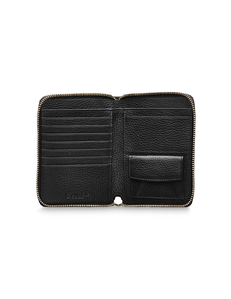 Madesimo wallet - Madesimo wallet - Women's wallet in soft napa leather. All-round zip with leather strap on puller. Eight credit card slots. Embossed Tiger of Sweden logo. Size: 10.5 x 13.5 cm.