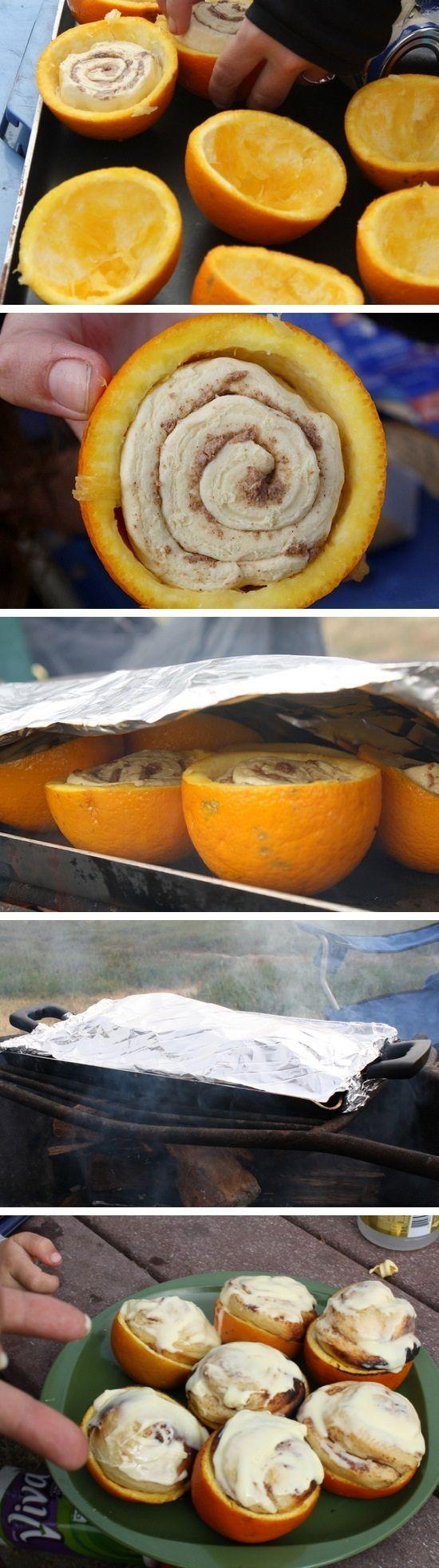 Campfire Cinnamon Rolls - a neat idea for family camping. Stick a cinnamon roll inside of an orange peel!
