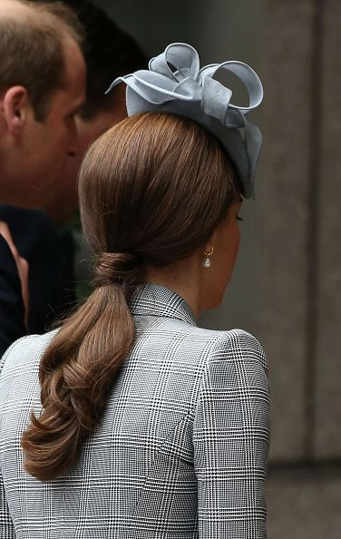 Making her first public appearance since announcing she was pregnant with her second child, Kate kept her hair simple with a chic ponytail while welcoming Singapore's President Tony Tan and his wife Mary to London as they began their State Visit, October 21, 2014.