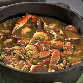 Louisiana Seafood Gumbo!! dont give me know gumbo without crab legs, shrimp, okra, and oh, add some chicken wingettes, and sausage too!! better be messy!!