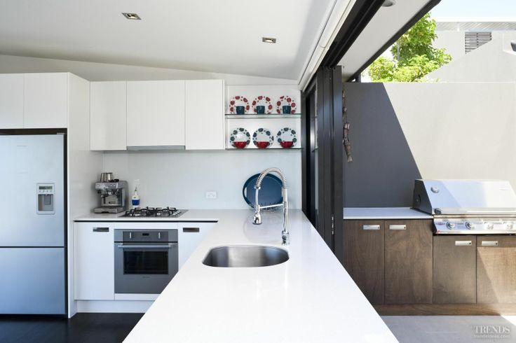indoor/outdoor kitchen and bbq - like the layout and the window but nothing else
