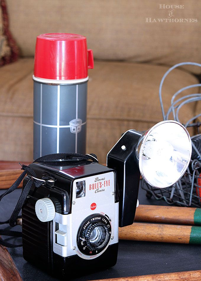 Vintage Brownie Bulls Eye Camera as part of a rustic vintage eclectic style summer home decor tour including vintage thermoses, cameras, typewriter and vintage croquet and badminton equipment.